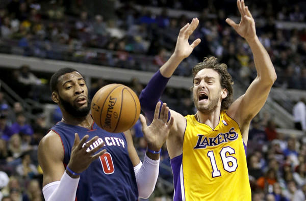 Lakers forward Pau Gasol (16) is fouled by Detroit's Andre Drummond Friday night in Detroit.