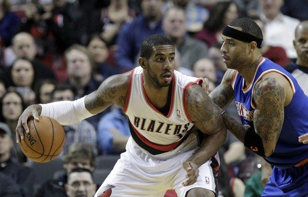 Portland's LaMarcus Aldridge backs in on New York's Kenyon Martin during the first half of a game on Nov. 25.