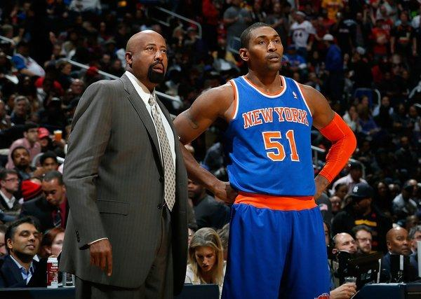 New York Knicks Coach Mike Woodson, left, and forward Metta World Peace, right, look on during a game against the Atlanta Hawks on Nov. 13.