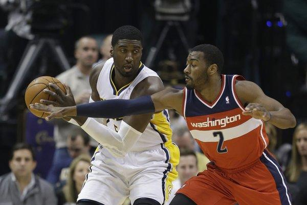 Indiana center Roy Hibbert is defended by Washington guard John Wall on Nov. 29. Hibbert and the Pacers lead the Eastern Conference with a record of 15-1 before heading into their Sunday matchup with the Clippers at Staples Center.