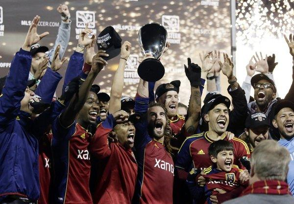 Members of Real Salt Lake celebrate their Western Conference final victory over over the Portland Timbers on Nov. 24. Real will face Eastern Conference champ Sporting Kansas City for the MLS Cup on Dec. 7.