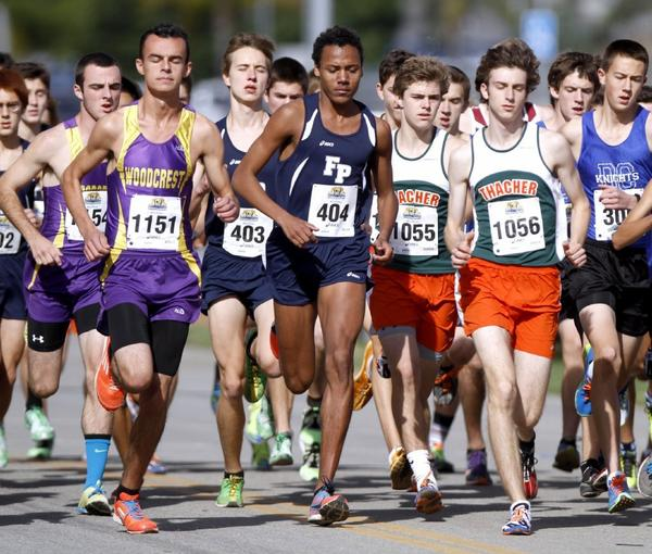 Flintridge Prep senior Alan Yoho captured the Division V state individual title in a personal-best time of 15 minutes, 11 seconds in topping two-time defending state champion Trevor Reinhart (15:24) of Marin Academy. (Raul Roa/File Photo).