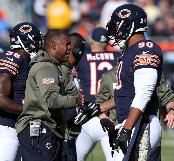 Bears defensive coordinator coach Mel Tucker congratulates defensive end Julius Peppers.