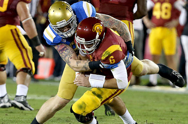 UCLA defensive end Cassius Marsh sacks USC quarterback Cody Kessler for the second time in the first quarter Saturday at the Coliseum.