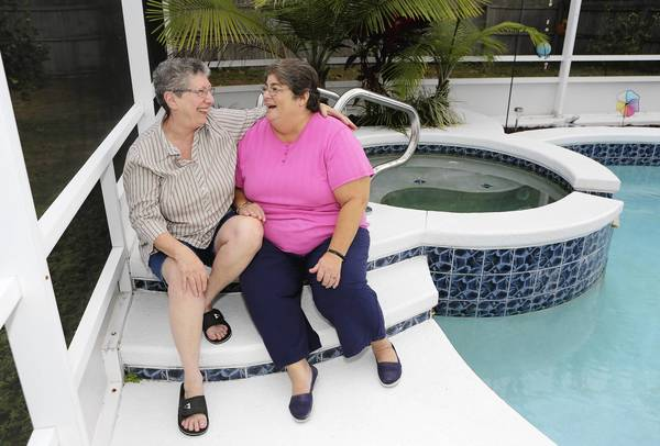 Janice Witter, left, and Cheryl Centrella of Eustis, pictured at their home, recently signed up for Tavares' domestic-partner registry. More than two dozen unmarried couples have registered as domestic partners in Tavares six months after the city put a registry in place.