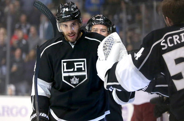 Kings forward Dwight King is congratulated by goalie Ben Scrivens after scoring one of two goals against the Phoenix Coyotes earlier this season at Staples Center.