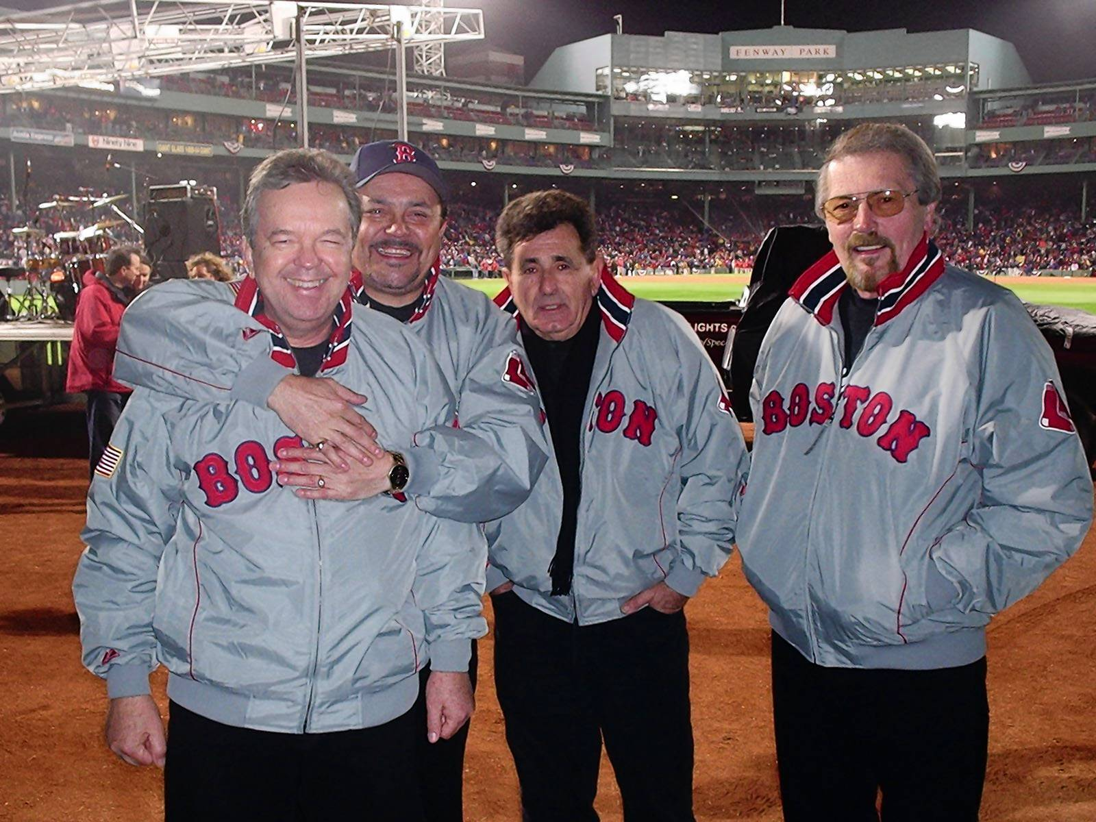 "Dick Dodd, second from left, with Standells bandmates Larry Tamblyn, Tony Valentino and Gary Lane at Fenway Park during the the 2004 World Series. The band's hit ""Dirty Water,"" with its refrain ""Boston, you're my home,"" held special renown in the city."