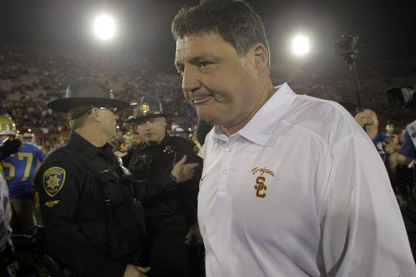 USC interim coach Ed Orgeron leaves the field after a 35-14 loss to UCLA on Saturday at the Coliseum. The Trojans were 6-2 under Orgeron.