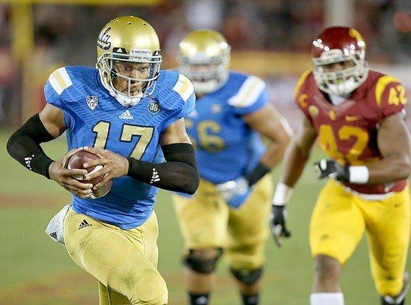 UCLA quarterback Brett Hundley tucks the ball and heads for the end zone during the third quarter of the Bruins' 35-14 win over USC last Saturday.