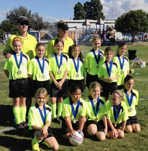 The AYSO Region 57 (Corona del Mar) girls' U-10 Highlighters Fall Recreation team captured the Region 57 division championship.