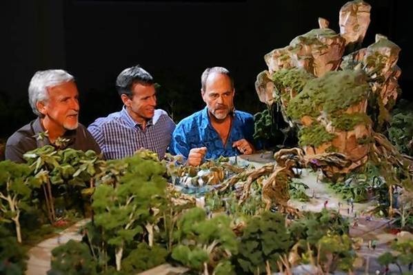 Joe Rohde (right) of Walt Disney Imagineering looks at a model of the Avatar-themed land with James Cameron (left) and Walt Disney Parks & Resort Chairman Tom Staggs.