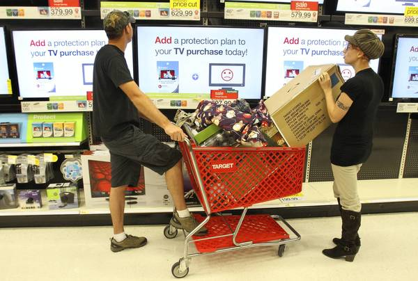 Ryan and Katrina Winesett look at televisions on Black Friday. Folks shopped for bargains during the Black Friday sale at Target in Mount Dora.