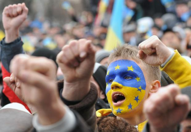 Protesters shout slogans during an opposition rally in Lviv, Ukraine.