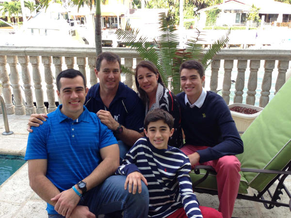 Navy football player Rafi Montalvo (left) at home with his family for Thanksgiving. Father Ralph is to his right, mother Ivette and his two brothers.