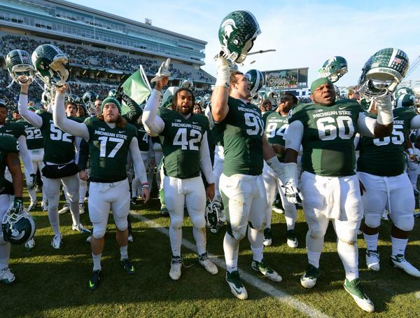 Michigan State players celebrate the victory against Minnesota.