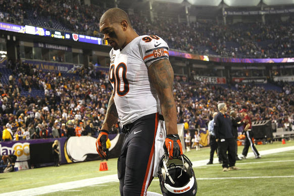 Bears defensive end Julius Peppers walks off the field after a 23-20 overtime loss.