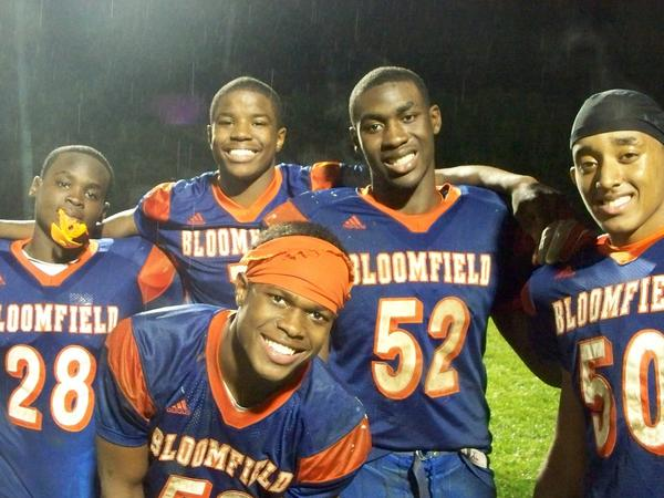 Jamar Johnson (52), pictured with his Bloomfield High School teammates in a 2011 photo, died in a car crash in the summer of 2013, just before his sophomore season at CCSU.