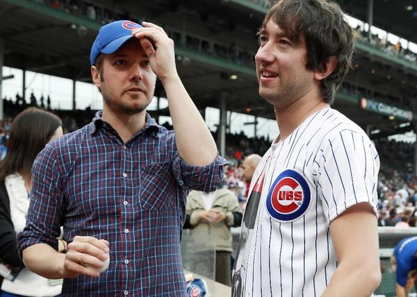 Plain White T's band members Dave Tirio (left) and Tom Higgenson (right) stand near the Cubs dugout at Wrigley Field Aug. 22, 2013.
