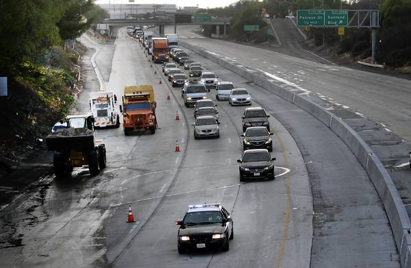 California motorists spend more than $600 a year fixing flat tires, aligning wheels and repairing other damage caused by potholes and bad pavement, according to Will Kempton, who ran the state Department of Transportation from 2004 to 2009. Above, the 5 Freeway in Sun Valley.