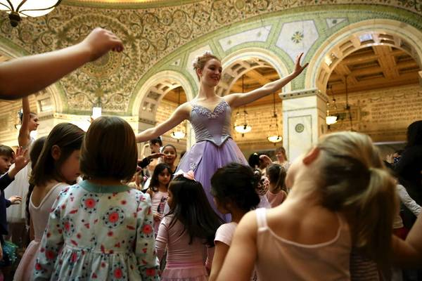Shea Smith, 17, with Ballet Chicago, dances with many admiring young girls at the end of the Dance-Along Nutcracker. At least a couple of hundred young children with their parents attended the event Sunday at the Chicago Cultural Center.