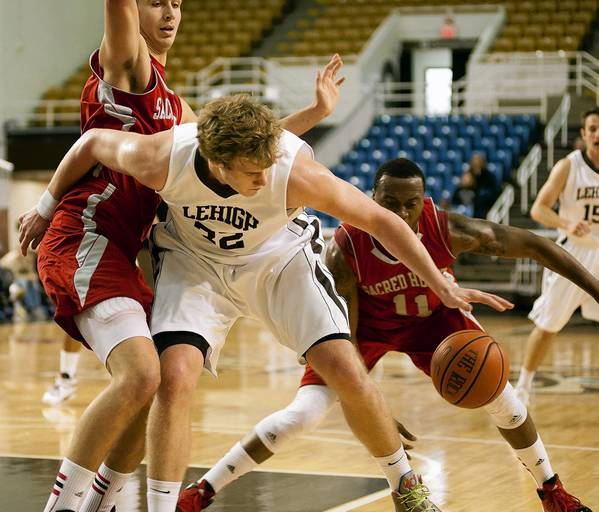 Lehigh University's Tim Kempton (32) tries to work the low post against Sacred Heart at Stabler Arena on Sunday.