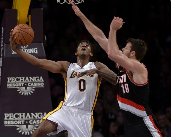 Nick Young, Joel Freeland