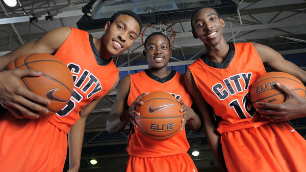 City basketball standouts Kamau Stokes, Omari George and Tim Bond.