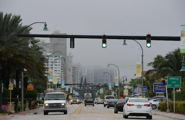 Buildings along Galt Ocean Mile recede into the morning fog as seen from, Lauderdale-by-the-Sea, Monday, Dec. 2, 2013.