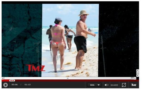 TMZ shows Congressman Joe Garcia on the beach, evidently with a friend. See full TMZ video: http://www.tmz.com/videos/0