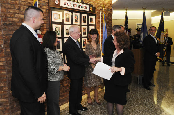 Berlin Town Clerk Kate Wall shakes the hand of newly sworn-in town council member Robert J. Dacey at Berlin Town Hall Tuesday night after she conducted the swearing-in ceremony. Other Town Council members are, from left, mayor Adam P. Salina, Rachel J. Rochette, Karen Maier Drost, David K. Evans, Stephen M. Morelli, and William A. Rasmussen, Jr.