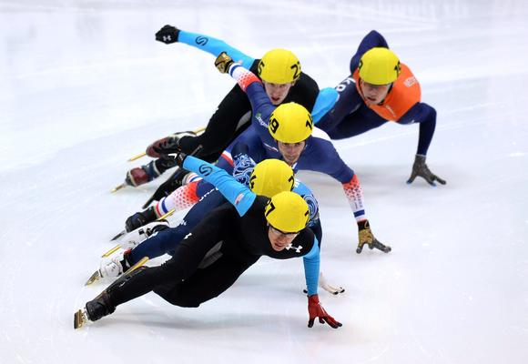 J.R. Celski in the lead as he won the 1,500 meters in the final World Cup meet of the season.  (Vasily Maximov / AFP / Getty Images)