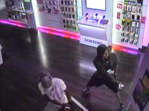Miramar Police are searching for two men who backed a truck through the glass doors of a T-Mobile store before stealing cellphones