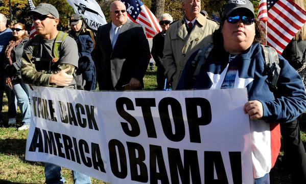 "Tea party and gun rights activists protest against President Obama during a ""Second American Revolution"" rally in front of the White House on Nov. 19."