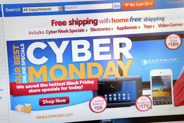 In this photo illustration, Walmart advertises Cyber Monday sales on the company's website.