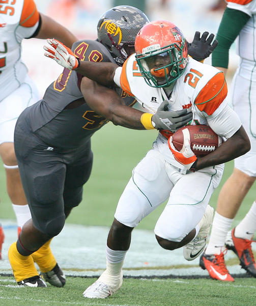 BCU defensive lineman Dyron Dyestops FAMU running back James Owensduring the Florida Classic college football game at the Florida Citrus Bowl in Orlando on Nov. 23.