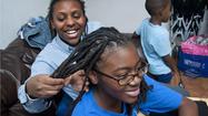 No dread: Private school cuts hair policy