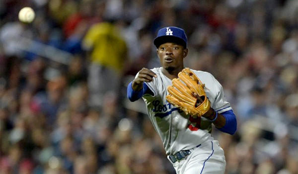 Dee Gordon's versatility as an infielder and outfielder are an advantage that could help him make the Dodgers' roster.