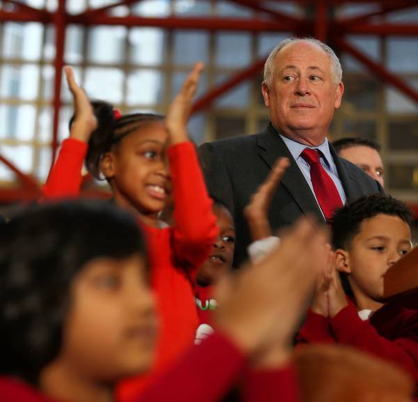 Gov. Pat Quinn joins students from Skinner West Elementary School to light the state Christmas tree and launch the Illinois Heroes Holiday Card Drive on Monday. On Tuesday, he'll be watching votes on the pension bill.