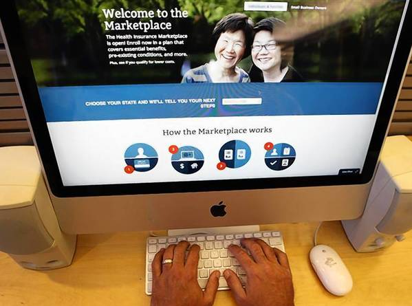 A man looks over the Affordable Care Act signup page on the HealthCare.gov website in New York in this photo illustration.