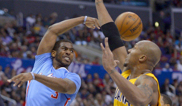 Chris Paul throws a pass behind Indiana's David West during the Clippers' 105-100 loss to the Pacers on Sunday.
