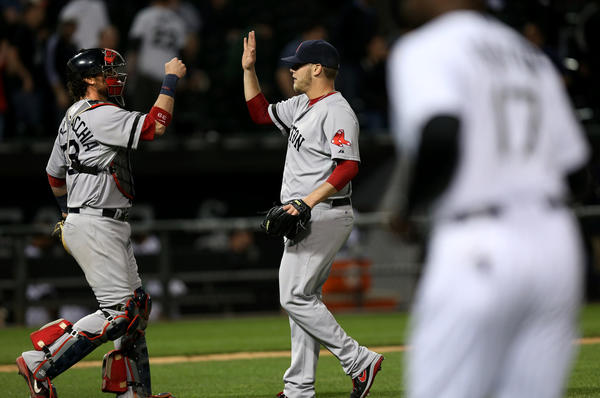 Red Sox relief pitcher Andrew Bailey celebrates with catcher Jarrod Saltalamacchia after beating the White Sox.