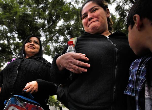 Adelina Garcia, left, and Adriana Serrano walk their kids home from Teresa Hughes Elementary School in Cudahy. The two mothers were leaders in a petition drive to oust the school principal.