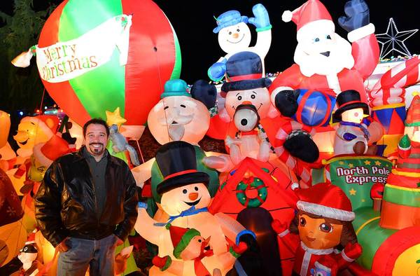 The Christmas display of David Rotondo, standing last year amid dozens of inflatable characters outside his home at 3415 Oregon St., Palmer Township, was a big hit with Bill White's tour groups last year.