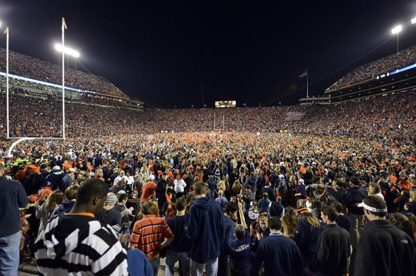 Auburn Tigers fans storm the field in celebration following their victory over the Alabama Crimson Tide.