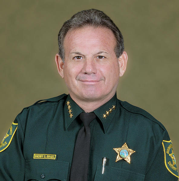 "For the past 30 years, Scott J. Israel has continually advanced into positions of increased responsibility as a law enforcement leader. He spent the first 25 years of his career with the Fort Lauderdale Police Department, a Florida State Accredited and CALEA Recognized Agency comprised of over 800 employees and retired in 2004 with the rank of Captain/S.W.A.T. Commander, when he accepted the position of Chief of Police at North Bay Village Police Department. During his tenure with the Fort Lauderdale Police Department, Scott Israel was assigned to the Community Policing Division, Police Operations Bureau and Special Investigations Division. As a member of those Divisions, he constantly demonstrated a unique ability to develop and maintain cooperative working relations with groups and individuals. As the Chief of Police in North Bay Village, he continued to foster strategic partnerships with the community, thereby enhancing the safety and well-being of the citizens; and was honored by the Dade County Police Benevolent Association as the 2005 Police Chief of the Year"".   Scott Israels substantial law-enforcement background includes significant senior command level experience, as well as, that of Police Chief in a South Florida Community that enjoys an integrated mix of cultures, ages, races, and ethnic backgrounds. He is a skilled leader and an accomplished manager of resources with a talent for inspiring teamwork among public safety personnel, citizen groups and community leaders. He has been successful in all areas of community policing, including crime prevention and crime control education and enforcement. He has a proven record as a fair and respected law enforcement leader and an ardent supporter of front-line personnel. In addition to possessing a B.A. Degree, he is a graduate of the FBI National Academy (212 Session). It is for these reasons that Scott J. Israel sought the Office of Broward County Sheriff and is convinced that by working together as a community, we can make the Broward Sheriff's Office not only the best run law enforcement organization in the Country, but also the kind of world class law enforcement organization, which it should be. On a personal level, Sheriff Scott J. Israel was the recipient of the 2008 Brian Piccolo Coach of the Year in recognition of his lifetime achievement in youth sports. ""Coach Scott"" has been the head coach of the Coral Springs Charger's Tackle Football Team, and also coached football at Stoneman Douglas High School and North Broward Preparatory Academy. In 2008, Scott J. Israel was honored by the Sunrise Democratic Club as ""Democrat of the Year."""