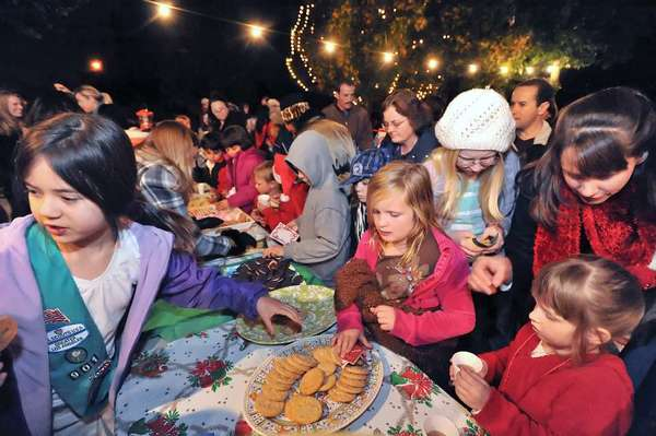 La Canada Girl Scouts enjoy cookies and cider during the 2010 Glenola Park Tree-Lighting and Canned Food Drive. This year's event takes place Dec. 4