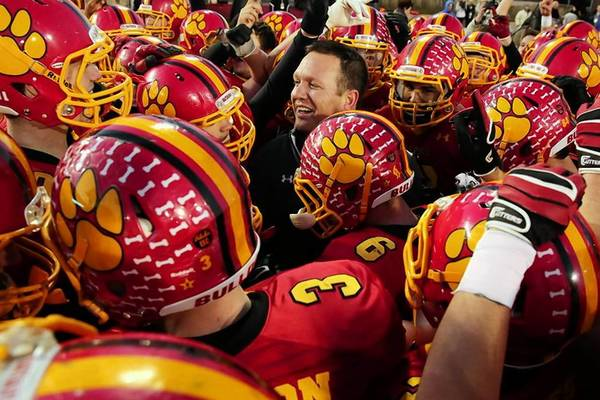 Batavia coach Dennis Piron celebrates with his team after they won the Class 6A football championship Saturday in DeKalb.