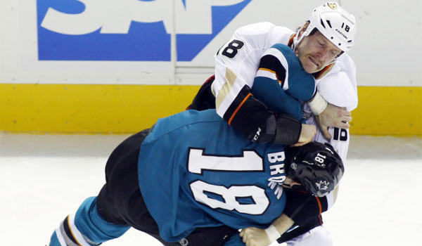 The Ducks' Tim Jackman, top, fights with San Jose's Mike Brown.