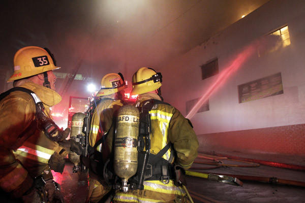 Los Angeles firefighters battle the fire in Echo Park in 2012