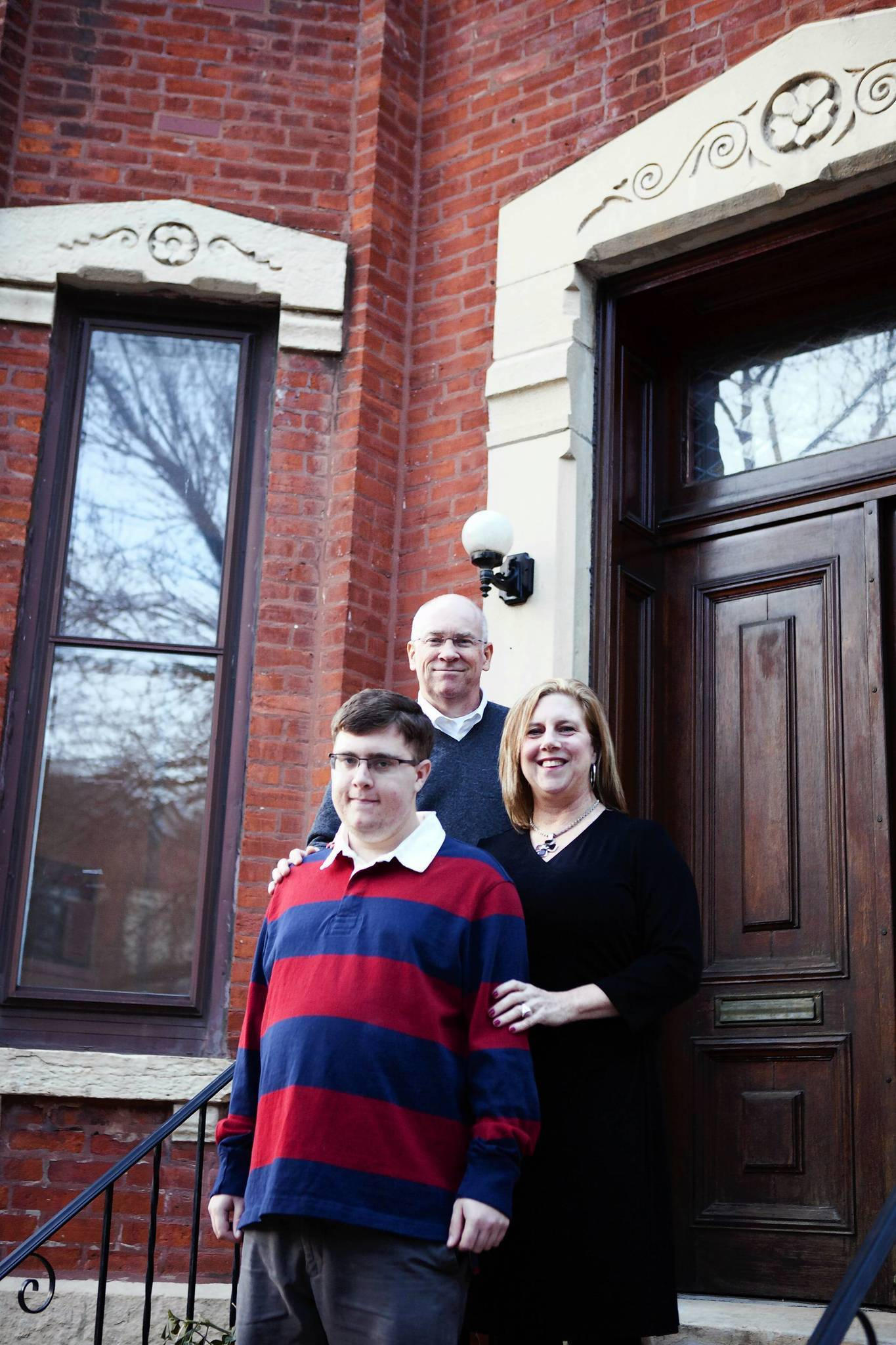 Julie and Michael Tracy started a foundation to help their 21-year-old son, John, and others who afflicted with autism and a mental disorder. The foundation has purchased a four-bedroom Victorian home, in background, near the University of Illinois at Chicago campus to house adults with autism. It is to open in the spring.